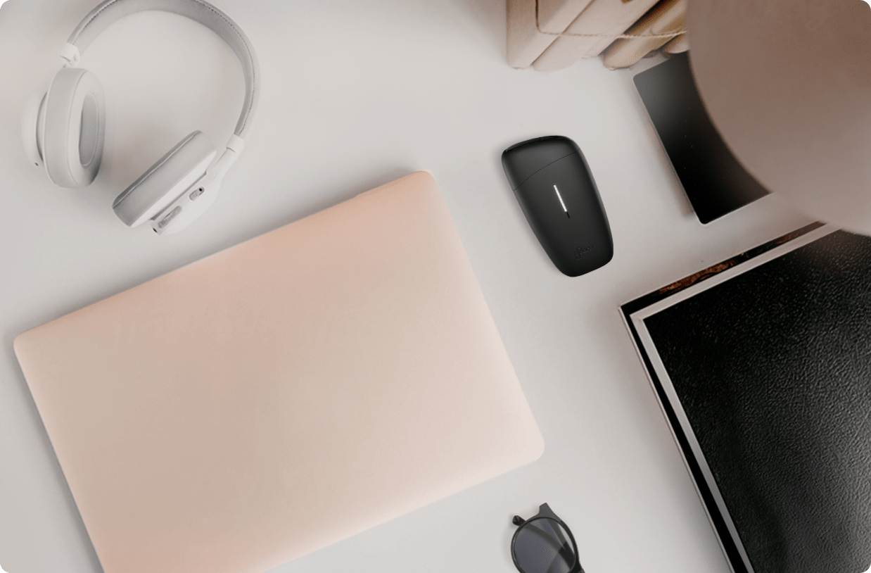 Ploom device on desk with other items